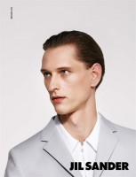 After starring in Jil Sander's fall-winter 2014 campaign, model Rogier Bosschaart reunites with the brand for its upcoming spring-summer 2015 advertisements. Hitting the photo studio with photographer Collier Schorr, Rogier delivers a minimal close-up, highlighting Jil Sander's minimal details, here reflected with a zippered dress shirt and a blazer with narrow lapels.