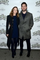 Attending the opening night of Broadway's 'Elephant Man' with his wife Emily Blunt on December 7th, actor John Krasinski stopped to pose for a photo. For the occasion, Krasinski wore a look from American designer John Varvatos, pairing one of his signature double-breasted coats with a simple jean and sweater combo.