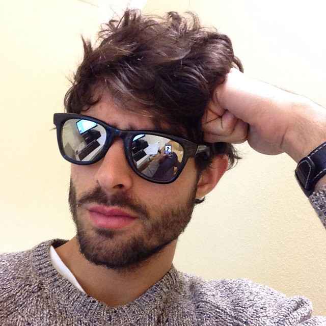 Juan Betancourt tries out some mirrored sunglasses