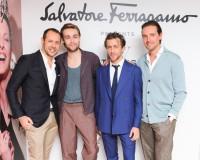 Salvatore Ferragamo creative director Massimiliano Giornetti poses for a group photo with Douglas Booth, Francesco Carrozzini and Alex Gilkes