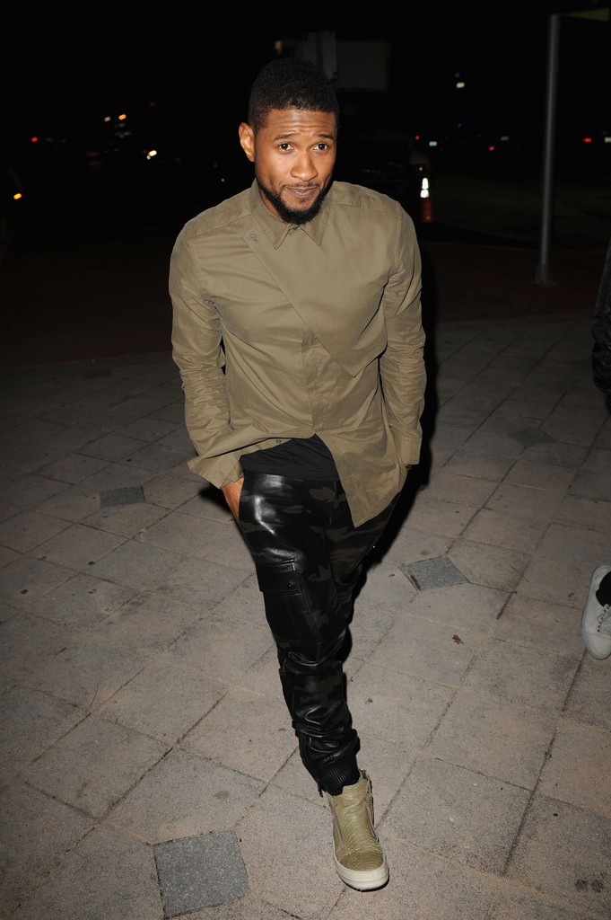 Making a strong style statement, Usher attended the Mercedes-AMG and Lufthansa ARTHAUS reception on December 2nd in Miami, Florida. For the event, Usher paired a Helmut Lang 'Storm Flap' twill shirt with camouflage leather pants and Rick Owens 'Island Dunk' sneakers.