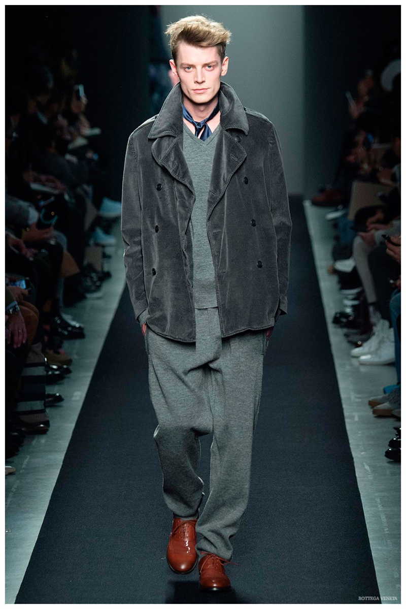 Bottega Veneta Fall-Winter 2015 Menswear Collection. Taking a relaxed approach to the season, Bottega Veneta creative director Tomas Maier delivered a cheeky collection with loose, slouchy proportions. Inspired by the idea of sweatpants and leisurewear, among the affair was a rich, double-breasted, gray corduroy jacket.