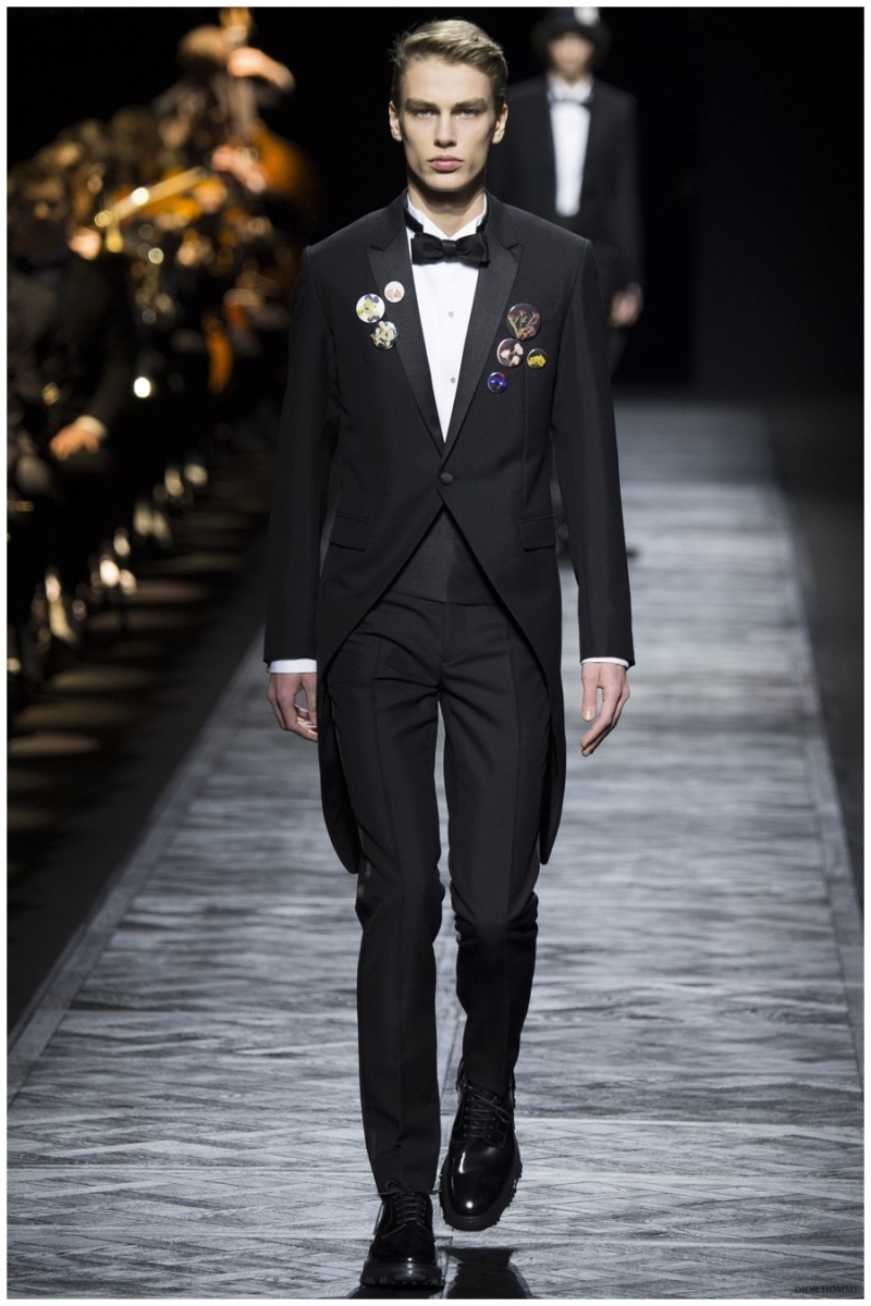Dior Homme Fall-Winter 2015 Menswear Collection. One idea that Dior Homme creative director Kris Van Assche prides himself on is making menswear accessible. Taking traditional pieces in a sportier direction, Van Assche set his sights on the tuxedo for part of his latest collection. The results were effortless proportions that deviated from the standard, adding length and style.