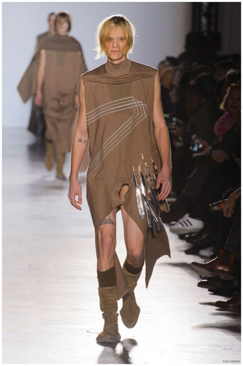 Rick Owens Fall-Winter 2015 Collection. Designer Rick Owens made headlines with his fall collection. Sending his models down the catwalk in revealing clothes that featured the penis on display, Owens championed equal objectification. Long tunics in earthy hues contributed to a unisex look.