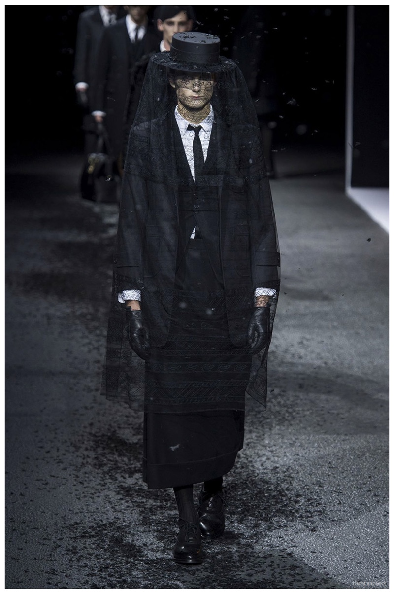 Thom Browne Fall-Winter 2015 Menswear Collection. American designer Thom Browne staged an impressive funeral for his fall outing in Paris. The star of the event was the mourning suit, revisited in chic layers with impeccable fits.