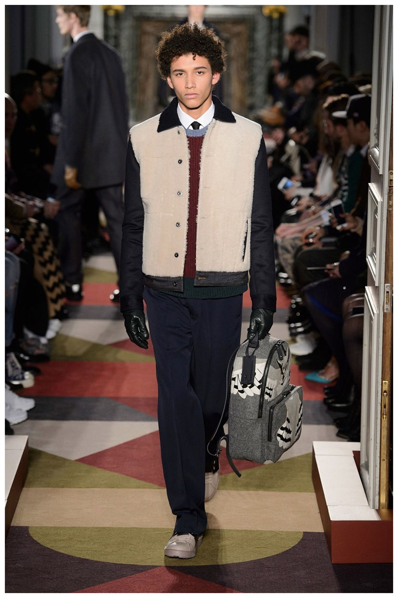 Valentino Fall-Winter 2015 Menswear Collection. Contrasting fabrics come together for Valentino's contribution to fall's shearling trend. Treated to a short jacket, Valentino's max flexes a casual approach to luxury wear.