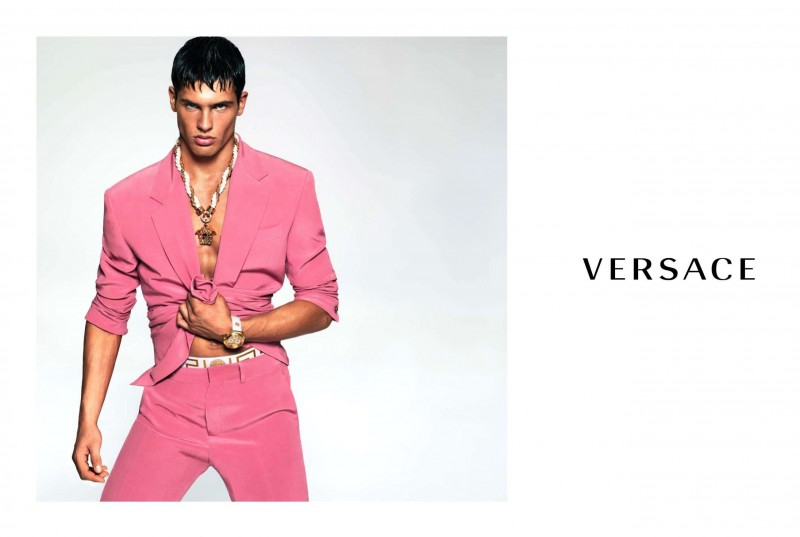 Model Miroslav Cech makes a Havana-inspired fashion statement, wearing a pink suit for Versace Men's spring-summer 2015 campaign.