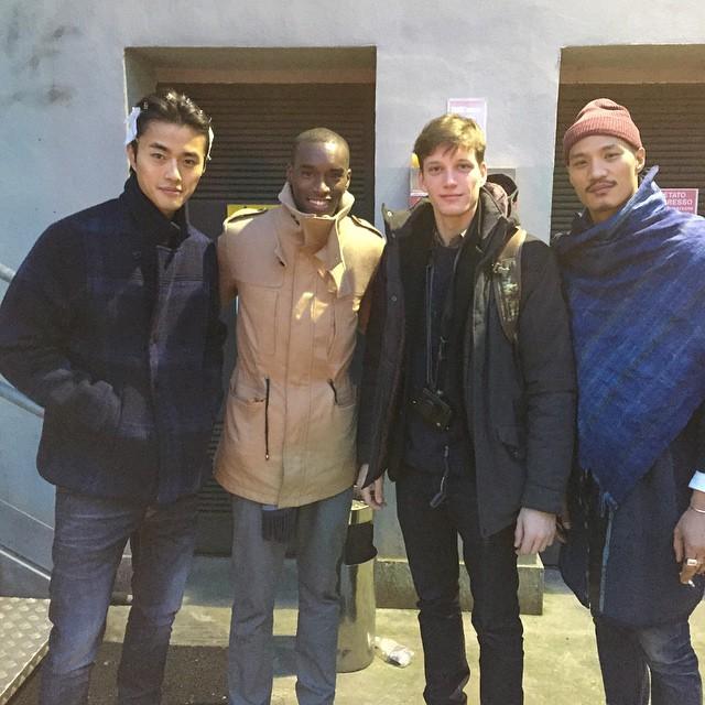 Zhao Lei, Corey Baptiste, Florian Van Bael and Paolo Roldan pose for an image at Giorgio Armani's show