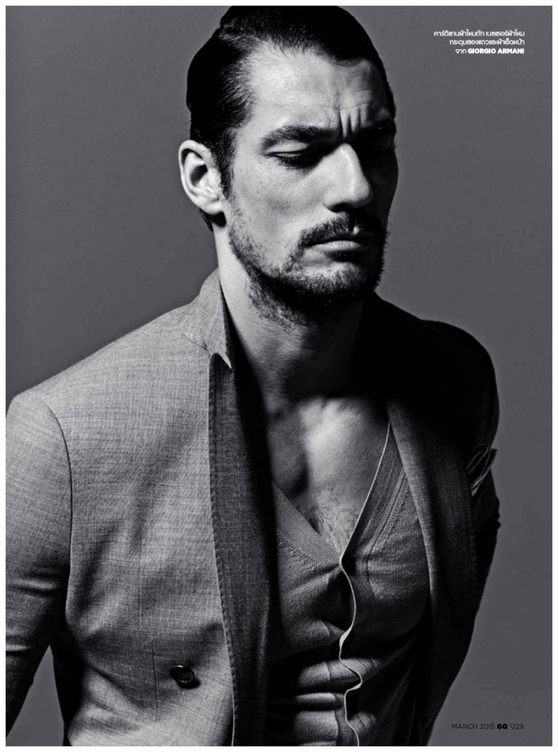 David Gandy wears a cardigan sweater with a jacket from Giorgio Armani.