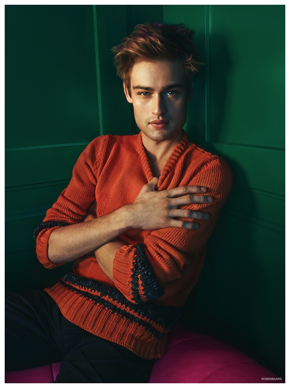Embracing a pop of color, Douglas wears a orange Hermes sweater.
