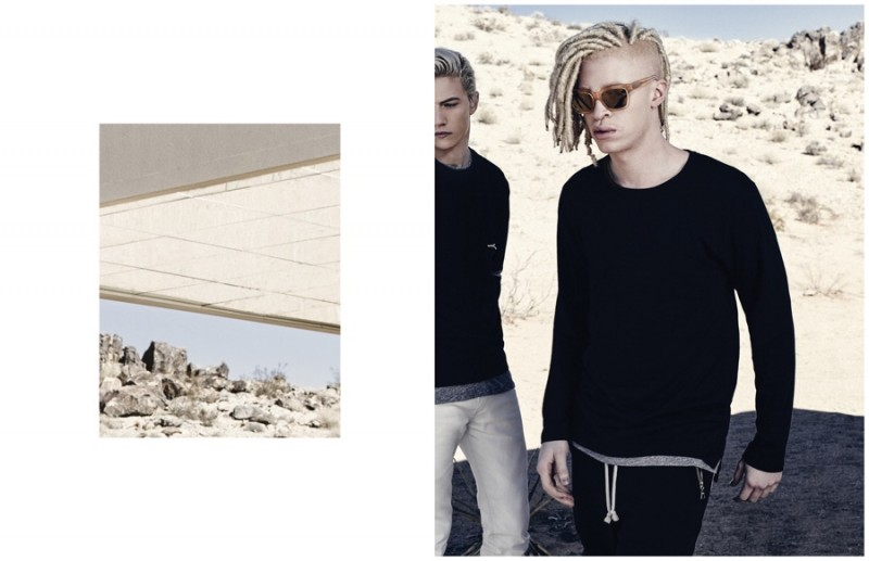 Rocking dreadlocks, Shaun Ross is pictured in a black number featuring joggers with zippered pockets.