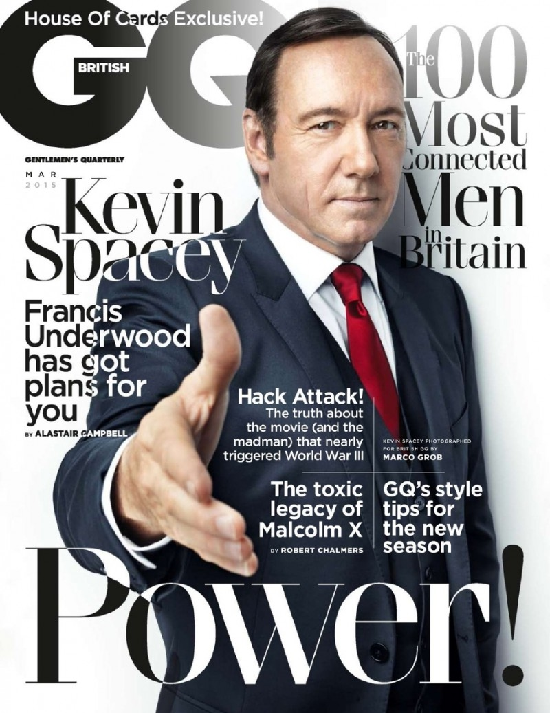 Kevin Spacey offers a helping hand on the March 2015 cover of British GQ.