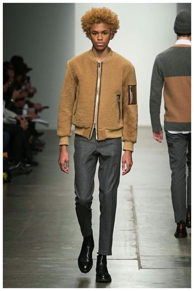 Ovadia & Sons Fall-Winter 2015 Menswear Collection. Unveiling its fall collection during New York Fashion Week, Ovadia & Sons delivered slender fits and a lineup of separates ideal for urban living. Highlighting the shearling trend, Ovadia & Sons sent out  a camel hued bomber jacket with modern details.