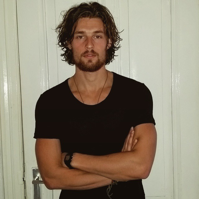 Wouter Peelen poses for an image before shaving his beard.