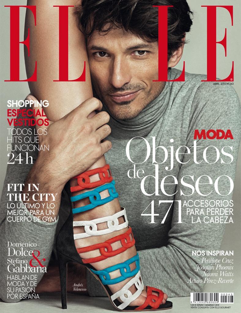 Spanish model Andres Velencoso Segura delivers a winning smirk for the April 2015 cover of Elle Spain.