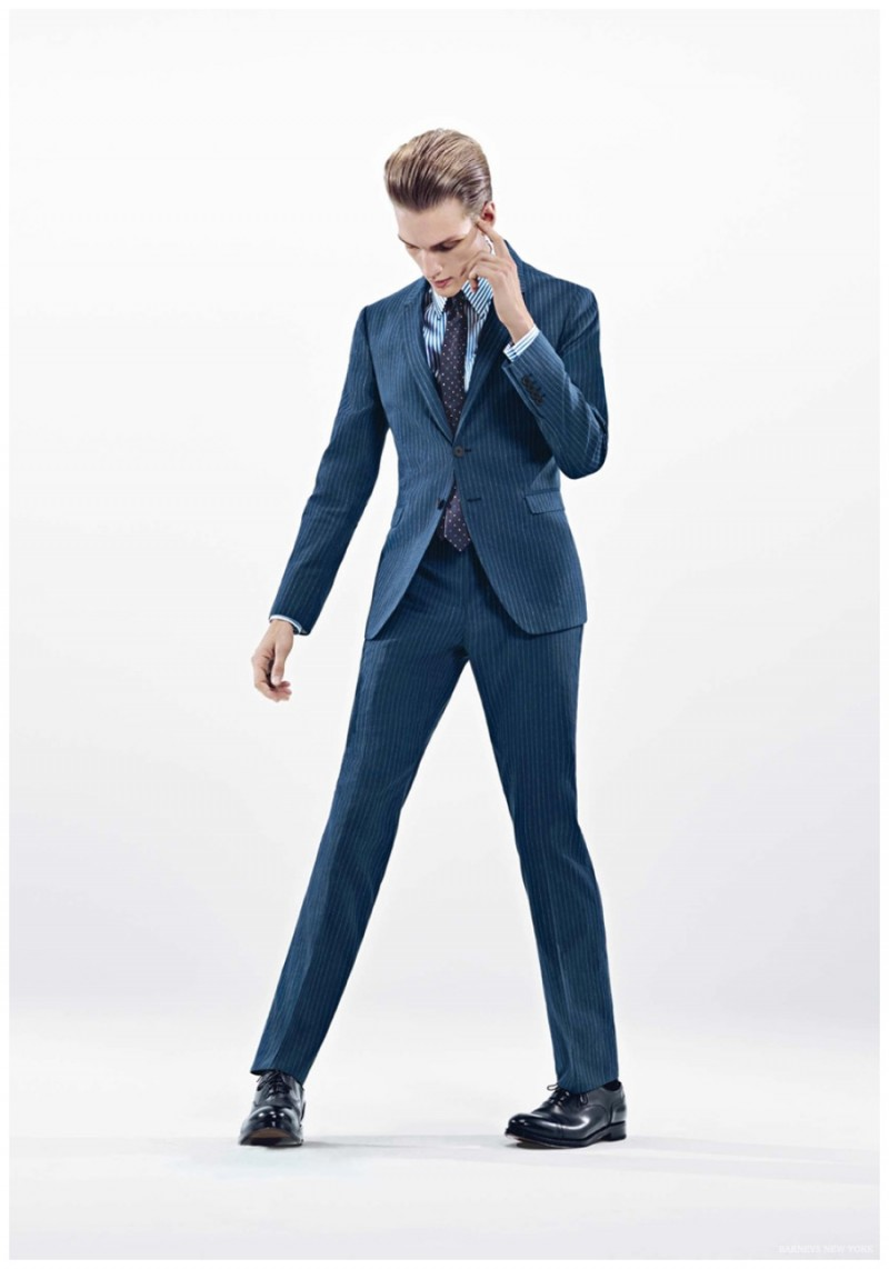 German model Paul Boche hits a sharp pose in the lean lines of Paul Smith.