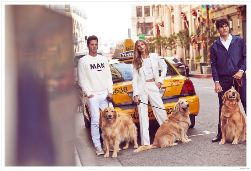 Ollie, Anna and Evandro pose with dogs.