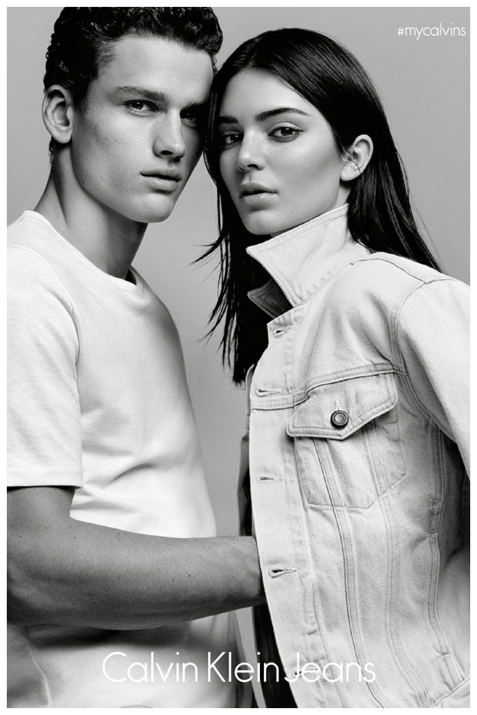 Modeling a white t-shirt, Simon Nessman joins Kendall Jenner for a photo.