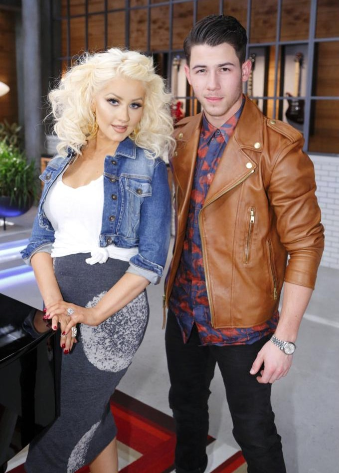 Nick Jonas poses for a picture with The Voice judge Christina Aguilera.
