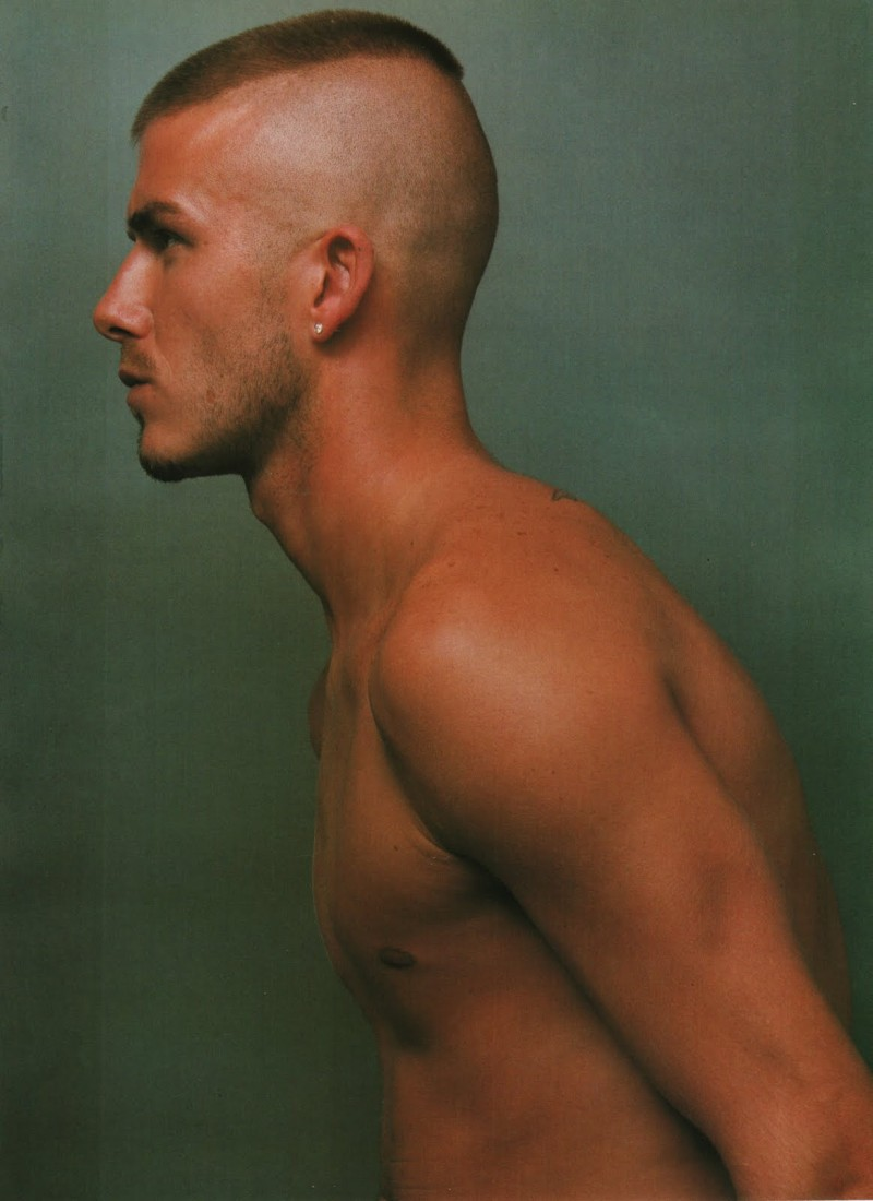 David Beckham photographed by Steven Klein for Arena Homme+ in 2000. Beckham sports a severe military style buzz cut.