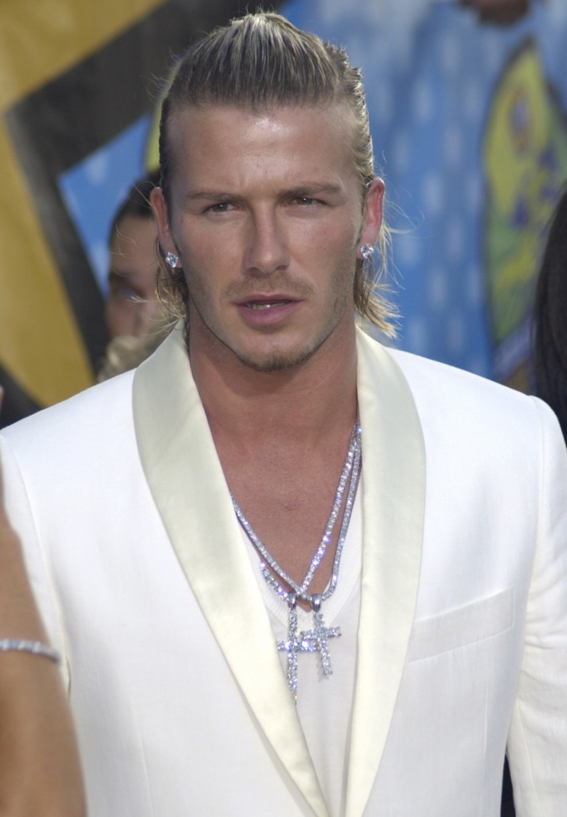 Sporting A Longer Blond Hair Style David Beckham Slicked His Back Into