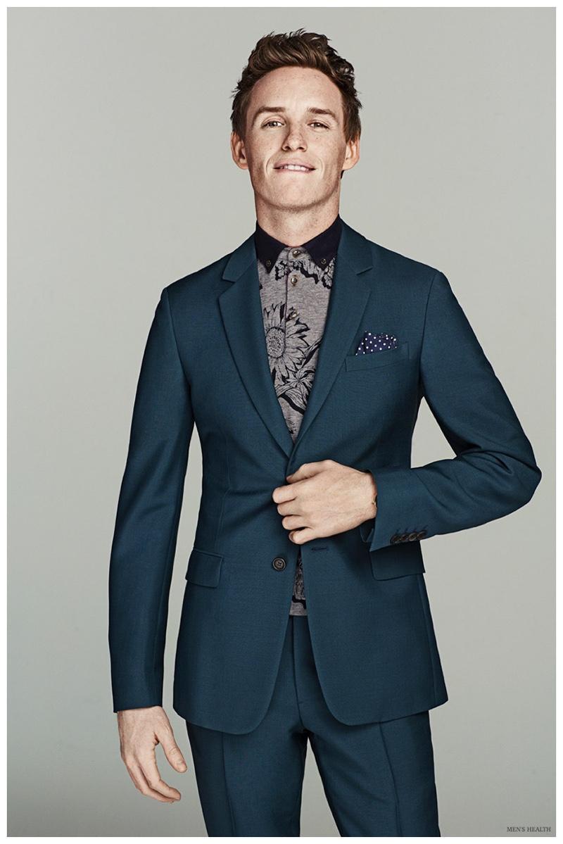 Eddie Redmayne cleans up in a striking green suit from Prada.