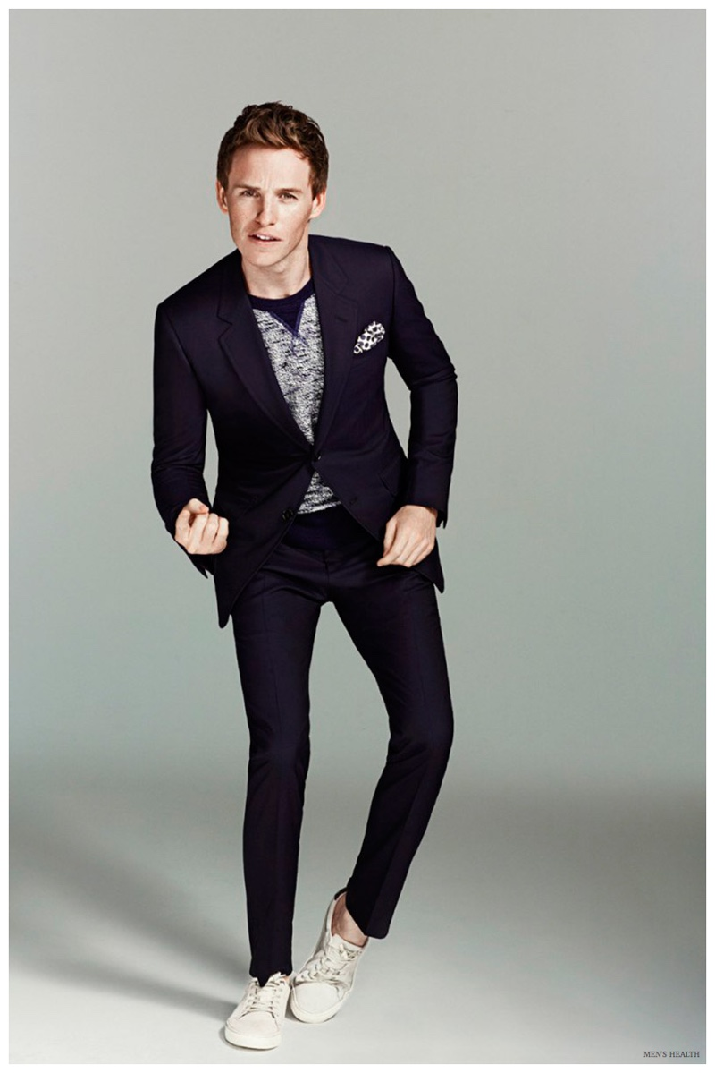 Eddie Redmayne wears a slim-cut Gucci suit.