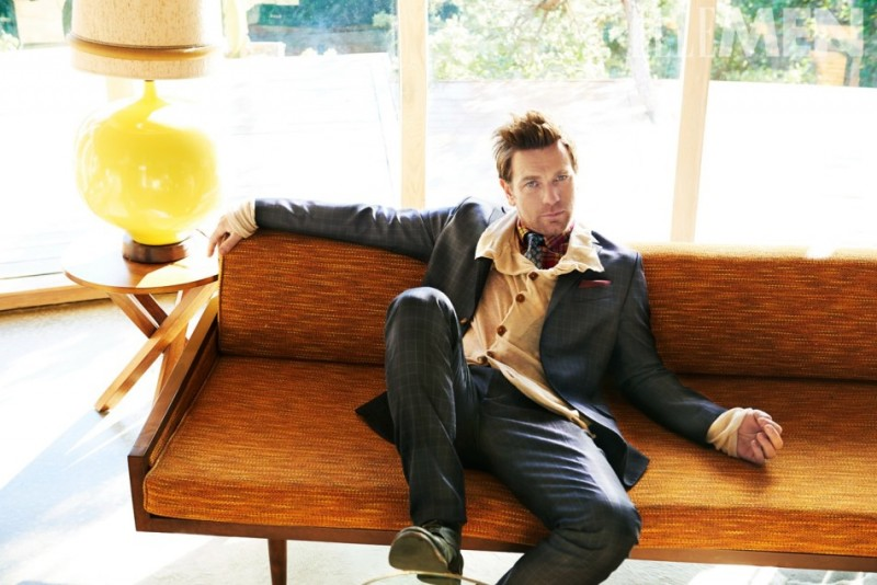 Relaxing indoors, Ewan McGregor layers with a cheeky knit.