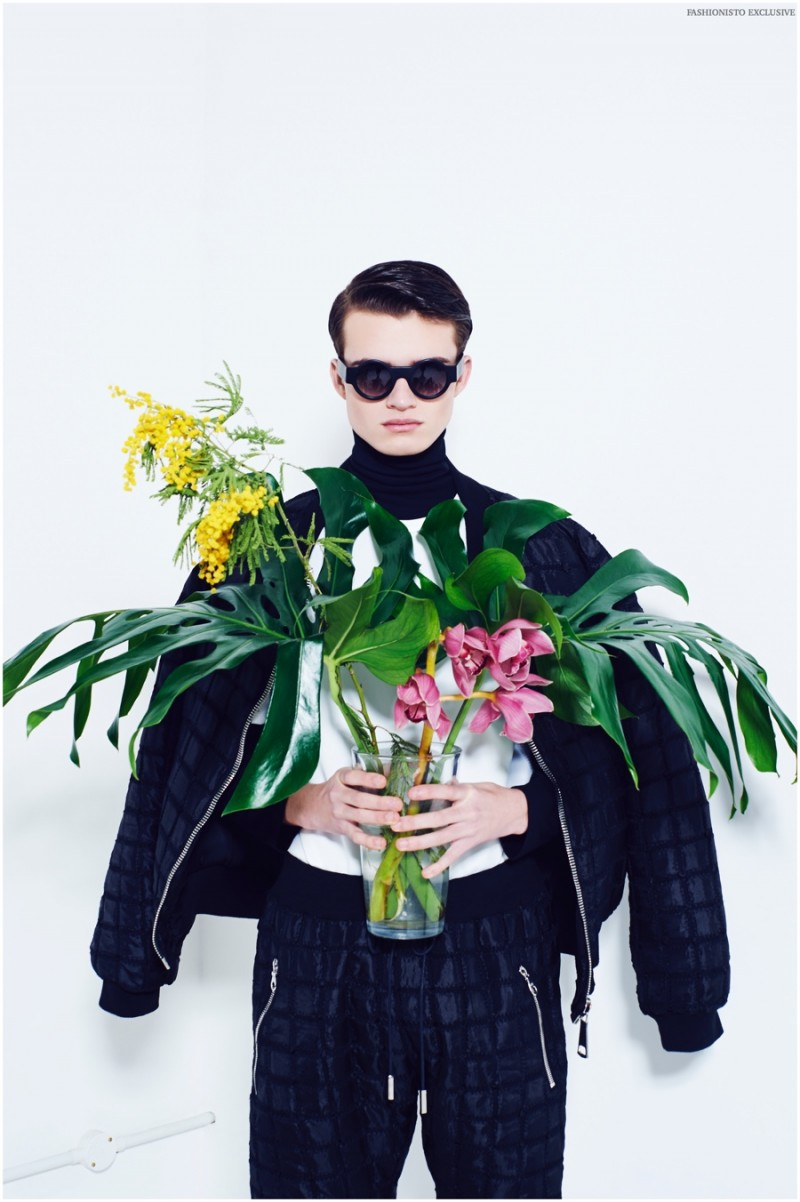 Reece wears sunglasses Black Eyewear, tee and turtleneck Topman, trousers and quilted jacket Hardware.