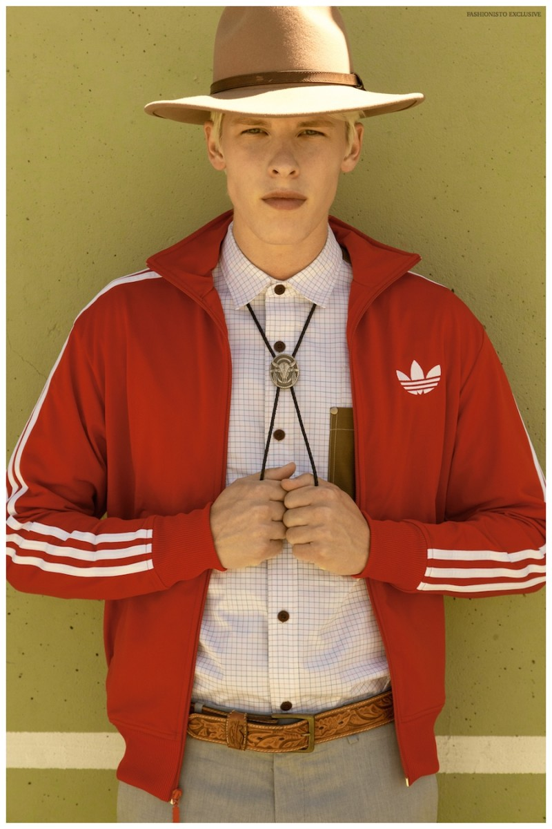 August wears zip up jacket Adidas, shirt Junya Watanabe from Modern Appealing Clothing SF, pants J.Crew, vintage belt stylist's own, hat Urban Outfitters and bolo tie from Wastelands SF.