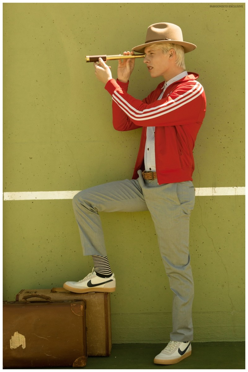 August wears zip up jacket Adidas, shirt Junya Watanabe from Modern Appealing Clothing SF, pants J.Crew, shoes NIKE, socks Happy Socks, vintage belt stylist's own, hat Urban Outfitters and bolo tie from Wastelands SF.