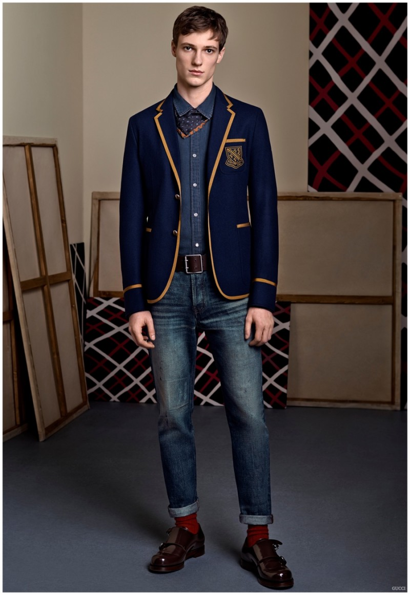 Enlist for the Gucci school of style with a sharp jacket featuring piping and a crest.