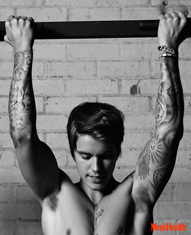 Justin Bieber does a pull-up.