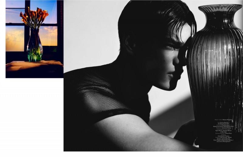 Filip Hrivnak poses for a moody black & white fashion image.