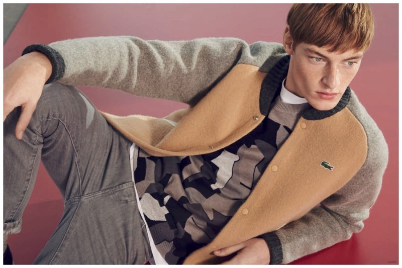 Roberto Sipos goes sporty in a colorblock bomber jacket from Lacoste L!ve.