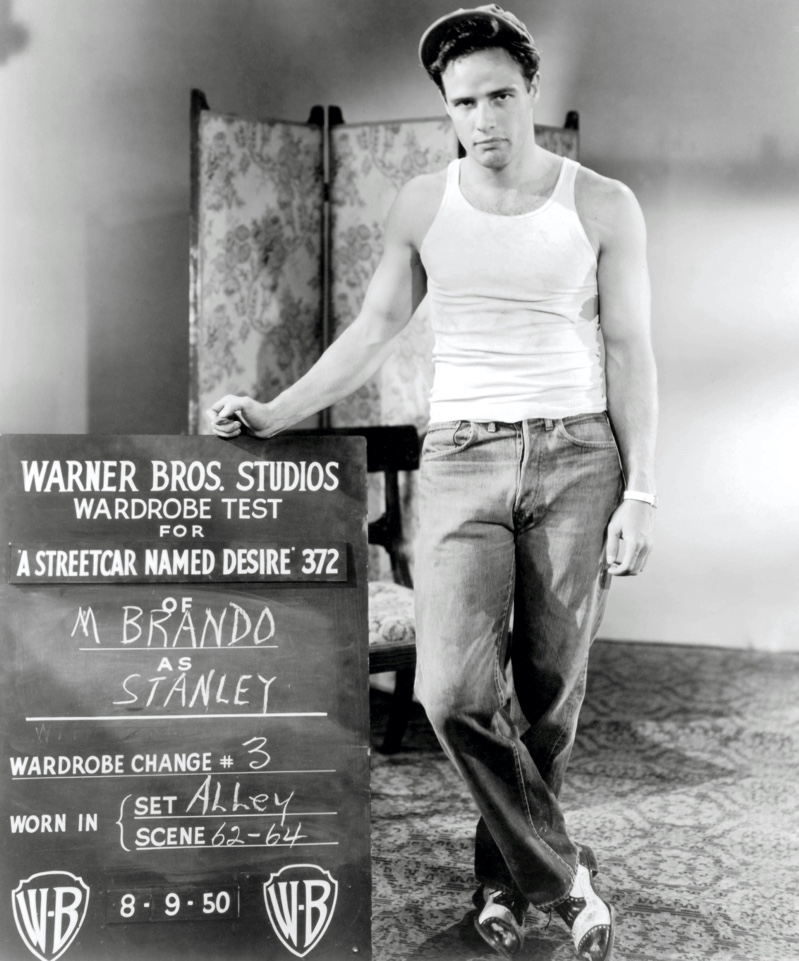 """Actor Marlon Brando poses for a wardrobe test for 1951's """"A Streetcar Named Desire."""" Portraying Stanley Kowalski, Brando wears a wife beater and jeans."""