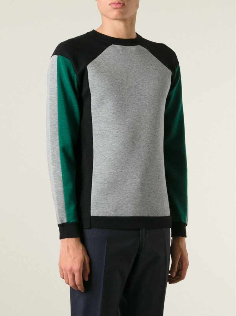 Looking to replicate Eddie Redmayne's smart look? Try a color block sweater from Italian label Marni.