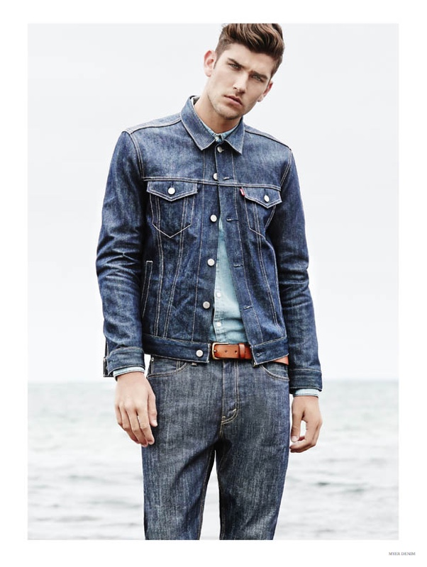 How to Wear Denim on Denim: Model Jack Vanderhart triples up on denim for a look that combines various washes for a denim jacket worn over a shirt with denim jeans.