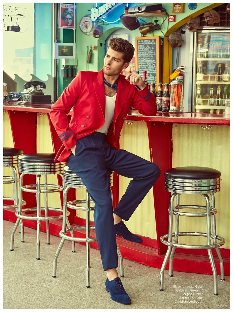 A standout in a red Gucci blazer, Paolo Anchisi stops for a moment of breather.