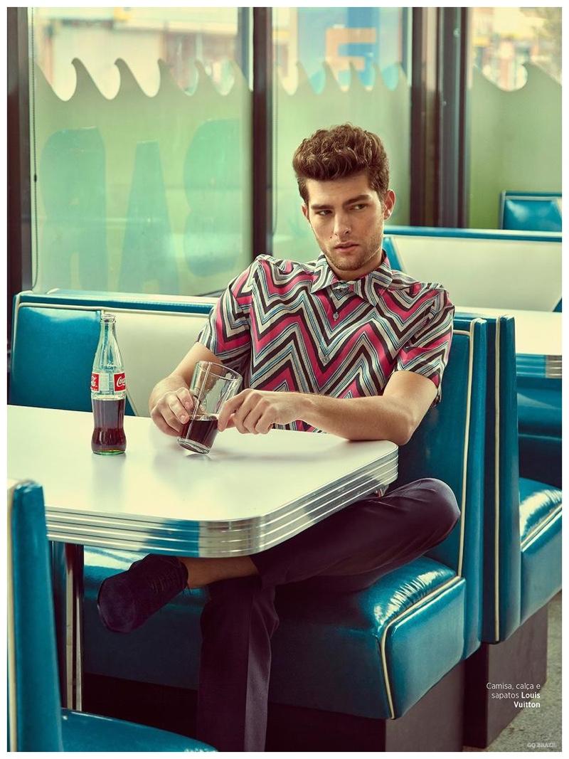 Enjoying soda pop, Paolo Anchisi wears a zigzag print shirt from Louis Vuitton.