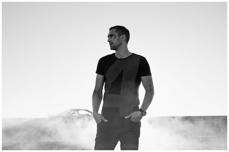 Captured in a black & white photo, Will Chalker is casual in a graphic t-shirt.