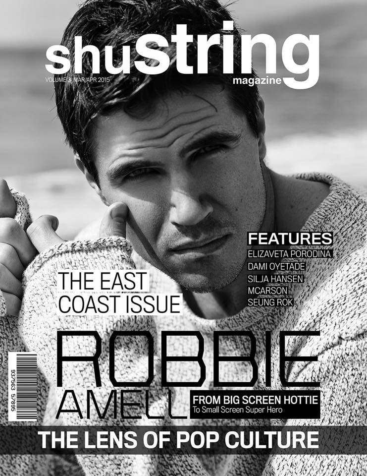 Robbie Amell covers the March/April 2015 issue of ShuString magazine as he hits the beach for a black & white photo.