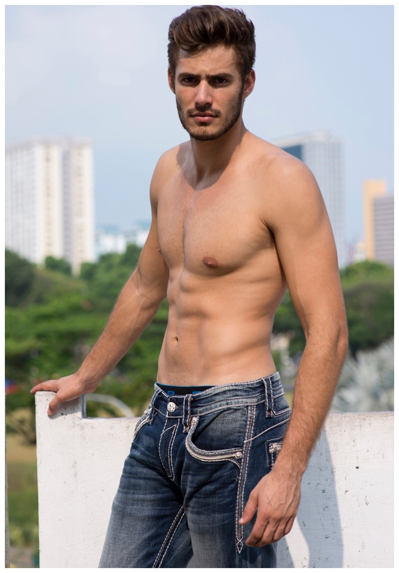 Roelof Theunissen delivers a shirtless portrait as he sports distressed denim jeans.