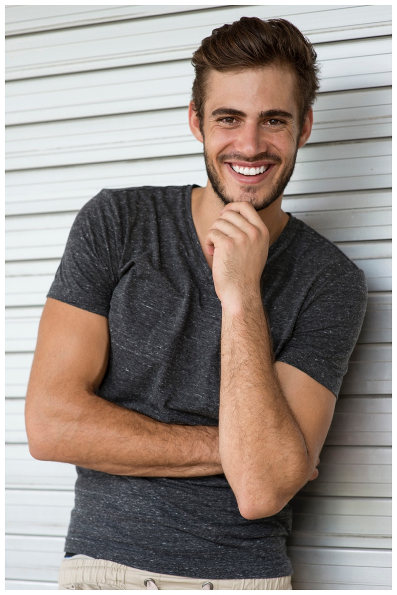 Roelof Theunissen is all smile in a simple gray v-neck.