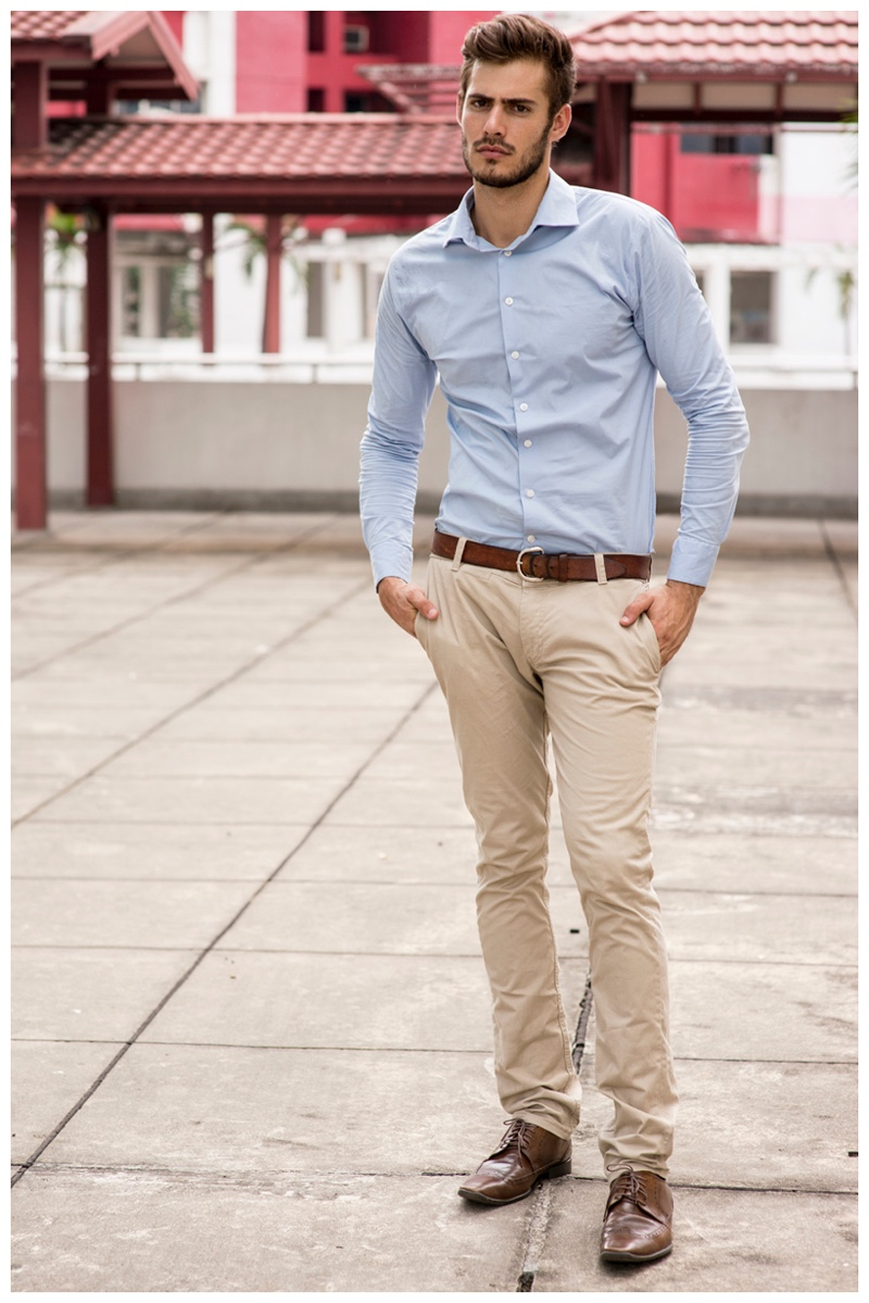 Roelof Theunissen cleans up in a classic oxford shirt and slim-cut khakis.