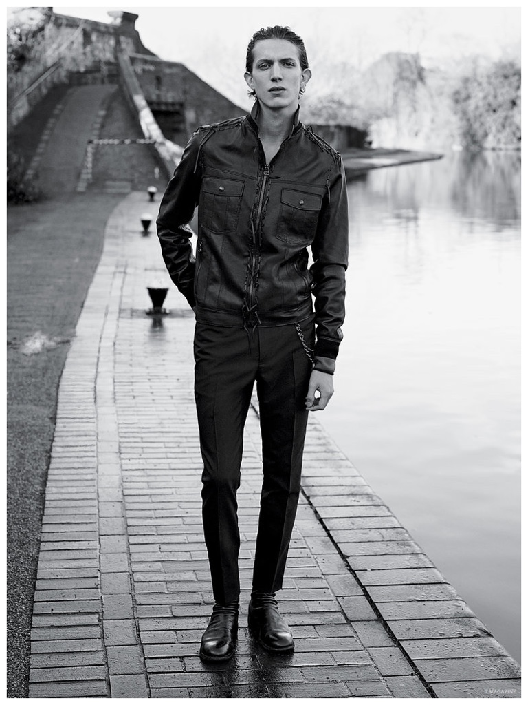 Xavier Buestel is confident and cool in a lean silhouette, wearing a Lanvin leather jacket with slim-cut, pleated trousers.