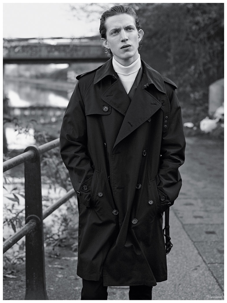 Xavier Buestel delivers a contemplative expression as he models an oversized trench from Ralph Lauren Purple Label.