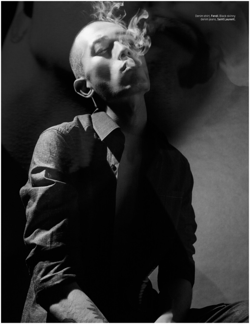 Sung Jin Park takes in a dramatic smoke.