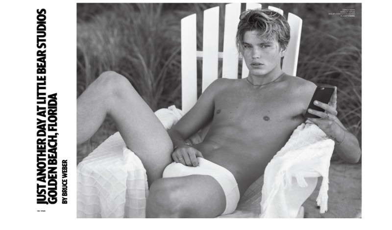 Model Jordan Barrett poses in a white swimsuit for the pages of VMAN.