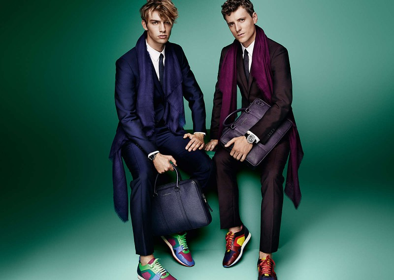 Photographed by Mario Testino for Burberry's spring 2015 campaign, George Barnett and George Le Page accessorize their suits with scarves in the same color scheme.